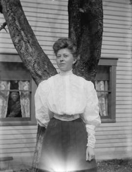 [Woman standing in front of tree]