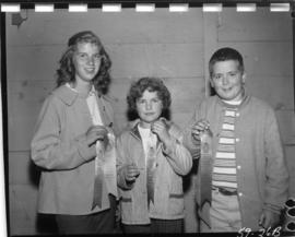 Children holding ribbons from 1959 P.N.E. 4-H Clubs and Future Farmers of Canada Show