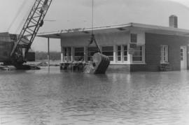 Crane, building and flood waters