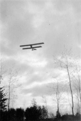 [A bi-plane in flight]