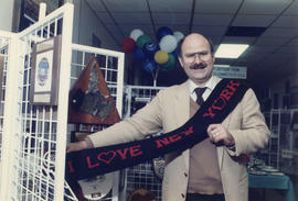 Mike Harcourt posing with a scarf at the Arts, Sciences and Technology Centre