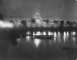 [View of the Parliament Buildings alight at night]