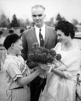 [Boy] receiving flowers