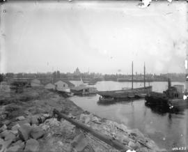 [View of Victoria harbour, showing ships, Spratt's Ark, and the Parliament Buildings in the ...