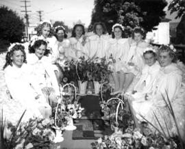 Girls and flowers on unidentified float in 1947 P.N.E. Opening Day Parade