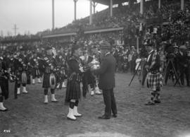 Caledonian Games [presentation of trophy to pipe corp]