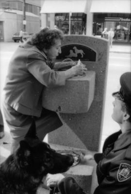 Theresa Galloway, Constable Rob Bosley and police dog Sport at drinking fountain