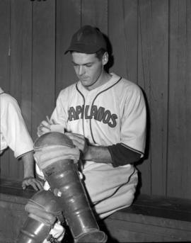[Capilanos baseball player sitting in the dugout]