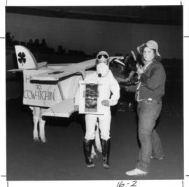 4-H cutest animal : [girl and cow in costumes for 1972 P.N.E. 4-H contest]