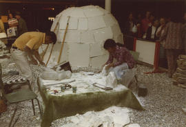 "Construction of model of ""Eskimo Camp"" in Modern Living Pavilion"