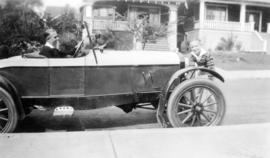 [Wilfred Arnold Sudbury (behind wheel) and Douglas Osborne Sudbury in front of car at 3628 West 3...