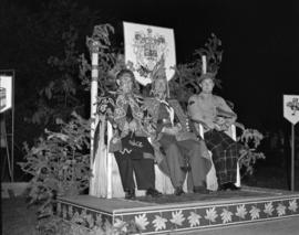 [Lord Alexander and his aide sitting with Chief William Scow during a ceremony to confer an honou...