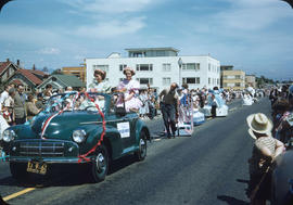 Parade, on Cornwall Street, car and children in floats and spectators