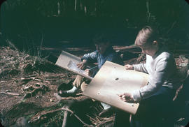 Boys drawing and writing in the woods at Camp Capilano