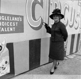 Woman by circus sign