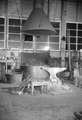 [View of forge and chimney at a shipyard]