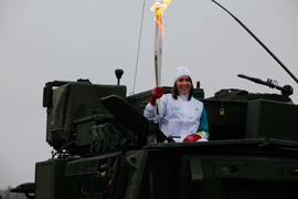 Day 27 Torchbearer 98 Andrea Kelly carrying the flame on Army Vehicle in CFB/BFC Gagetown, New Br...