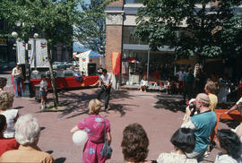 Vancouver Day attendees watching performer juggling