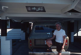 Man and station wagon at the Lees' residence in Duncan or Nanaimo, B.C.