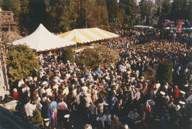 Crowd around Vancouver Centennial birthday cake at the Stanley Park Pavilion Gardens