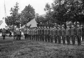 [Canadian riflemen, competing in Empire meet, lined up for inspection at] Bisley