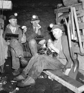 [Group of miners having lunch]