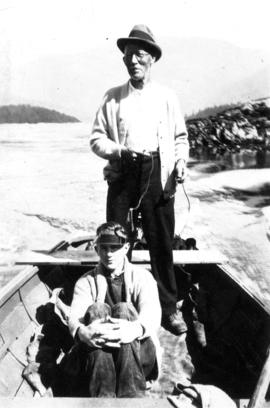 [Two men in boat, Stuart Island, B.C.]