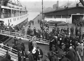 [Passengers - civilians and military - disembark from coastal steamer]