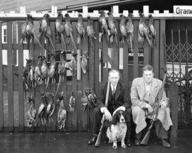 Bob Brown and Don McKenzie with bag of pheasants [and ducks]