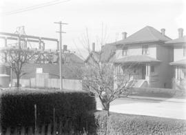 [View of Pender Street, showing houses and partially constructed Hoffmeister Building]