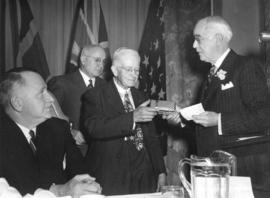 [Dr. Robert Matthison receives a gift from Mr. W.H. Malkin at a Vancouver Board of Trade luncheon]
