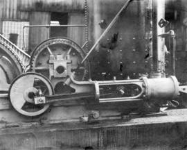 [Side view of gears of unidentified machine]