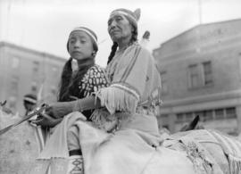[Stoney woman and girl on horse]