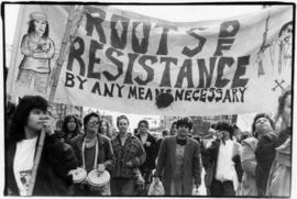 International Women's Day march [Roots of Resistance banner]