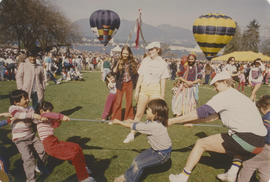 Children playing tug of war at Centennial birthday celebration in Stanley Park