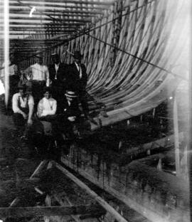 "[Ship builders on frame of the ""Coquitlam City""]"