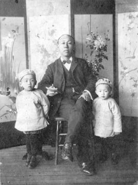 [An unidentified man with his two sons]