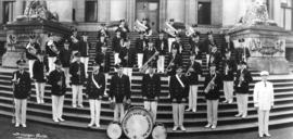 Group portrait of Firemen's Band of Vancouver assembled on Court House steps