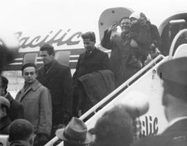 [Hungarian refugees deplane at the airport]