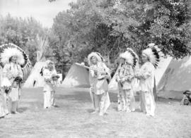 [Stoney Indians playing baseball at Calgary Stampede grounds]