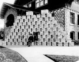 [Soldier in front of boxes of Canadian Field Comforts at Mrs. J.Z. Hall's residence - 2890 P...