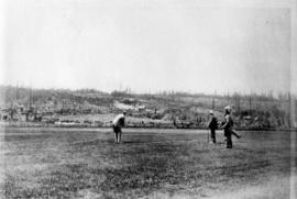 Men approaching fourth green with house of J. MacKenzie Bowell under construction in the distance