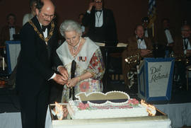 Mike Harcourt and Jeanne Sauvé cut cake during Centennial Ball at the Pan Pacific Hotel