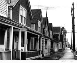 Houses row in 400 Block of Heatley Avenue, looking north from Pender Street