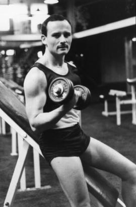 Unidentified man lifting weights