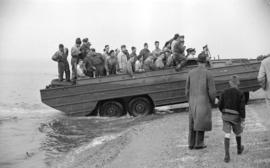 [Amphibious army truck driving from water onto Kitsilano Beach during a mock invasion]