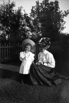 [Annie Louise Taylor and son Theodore Taylor in the yard of their home at Willow Street and 8th A...