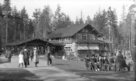 [People seated outside the Stanley Park Pavilion]