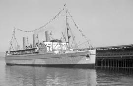 "[The ""Empress of Japan"" decorated with flags at dock]"