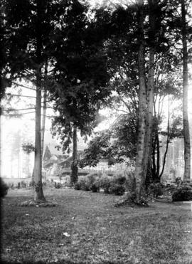[View through the trees of the] Refreshment Pavilion, Stanley Park